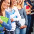 Education - line of students standing in line - Foto Stock