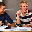 Modern teens - Happy students eating food - Stock Photo