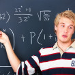 Royalty-Free Stock Photo: Education - Young man demonstrating algebra