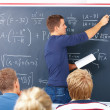 Education - Male teacher teaching algebra - Stock Photo