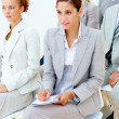 Royalty-Free Stock Photo: Business woman taking notes in  meeting