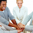 Teamwork - Business peoples piling hands showing unity - Stock Photo