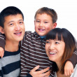 Royalty-Free Stock Photo: Smiling Asian family cut out on white