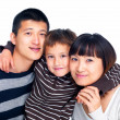 Royalty-Free Stock Photo: Portrait of a happy Asian family on white
