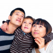 Royalty-Free Stock Photo: Asian family looking up at copyspace