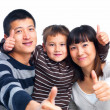 Succussful asian family giving thumbs up - Stock Photo