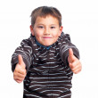 Successful boy giving thumbs up - Stock Photo