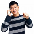 Asian guy calling and pointing at you - Stock Photo
