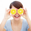 Royalty-Free Stock Photo: Concept - Woman with orange slices over eyes