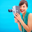 Royalty-Free Stock Photo: Fashionable woman using an old fashioned camera
