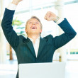 Royalty-Free Stock Photo: Successful business man raising his arms in joy