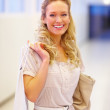 Royalty-Free Stock Photo: Closeup portrait of a smiling blond with shopping bag