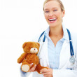Royalty-Free Stock Photo: Joyful childrens doctor smiling happily isolated