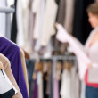 Royalty-Free Stock Photo: Blur image of a female selecting clothes at the store
