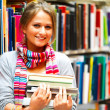 Royalty-Free Stock Photo: Pretty charming lady holding books in library