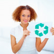 Environmentally friendly woman showing recycle symbol - Stock Photo
