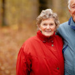 Autumn -  Elderly couple standing together - Stock Photo