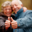 Royalty-Free Stock Photo: Portrait of elderly couple showing thumbs up