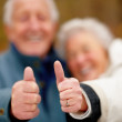Royalty-Free Stock Photo: Macro of aged couple showing thumbs up