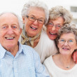 Portrait of older smiling happily - Stock Photo