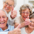 Success - Older giving thumbs up - Stock Photo