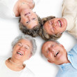 Joyful older putting their heads together - Stock Photo