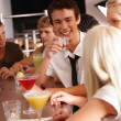 Royalty-Free Stock Photo: Group of young drinking  at a bar