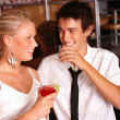 Royalty-Free Stock Photo: Happy young couple enjoying drinks