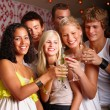 Royalty-Free Stock Photo: Happy young students toasting  drinks together