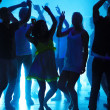 Royalty-Free Stock Photo: Young guys and girls dancing at a nightclub