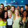 Royalty-Free Stock Photo: Group of friends standing together in a nightclub