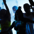 Joyful young dancing at nightclub - Stock Photo
