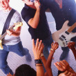 Rock band shouting to the audience - Stock Photo