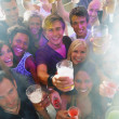 Royalty-Free Stock Photo: Closeup young men and women holding drinks at a party