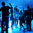 Silhouette of dancing at a disco - Foto Stock