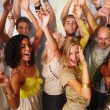 Young men and women dancing and having fun - Stock Photo