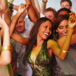 Closeup of young men and women dancing joyfully - Stock Photo