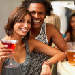 Royalty-Free Stock Photo: Closeup of a smiling young couple in a bar