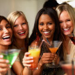 Royalty-Free Stock Photo: Closeup of a smiling young girls holding drinks