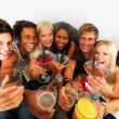 Young friends toasting drinks at a disco - Foto de Stock