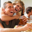 Smiling young guys laughing joyfully - Stock Photo