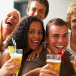 Royalty-Free Stock Photo: Smiling young boys and girls holding drinks