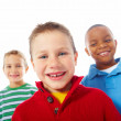 Closeup portrait of three charming kids over white background - Stock Photo