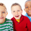Closeup portrait of three happy boys over white background - Stock Photo