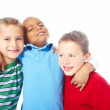 Closeup of young boy with arms around two friends - Stock Photo