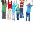 Royalty-Free Stock Photo: Six kids jumping with their hands raised over white background