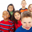 Closeup portrait of group of six kids together over white backgr - Foto Stock