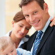 Royalty-Free Stock Photo: Happy business couple with their cute baby