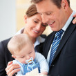 Royalty-Free Stock Photo: Smiling business couple with their cute baby