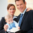 Royalty-Free Stock Photo: Successful business couple with their cute baby